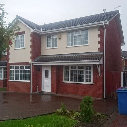 Detached house showing Door Master Liverpool windows and fascias